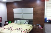 Bed frame with wall feature