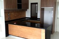 Wood Grain Kitchen Cabinet with Black Marble Top